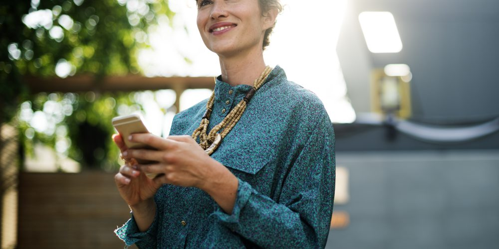 Businesswoman standing and using mobile phone